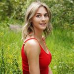 Profile image of Katherine Hoogstra wearing a red shirt in a green grassy field